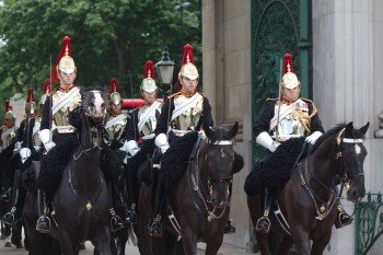 The Blues and Royals riding under Wellington Arch.