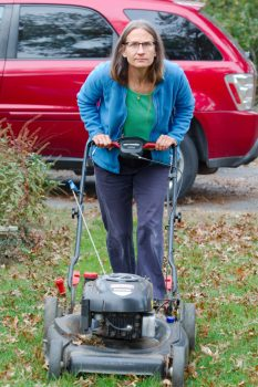 Cathy Mowing The Leaves