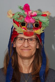 Cathy with a Chinese Dragon Hat