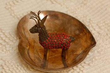 Metal Deer In a Metal Bowl